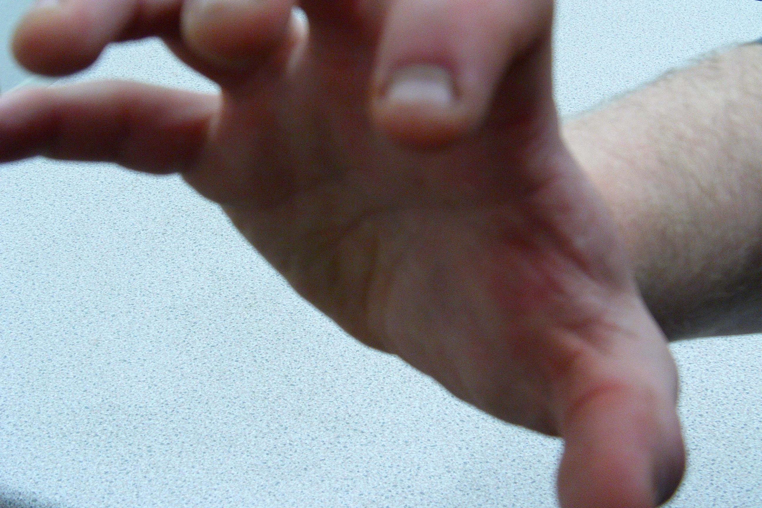 Hand Sign Holding Ring Finger Down